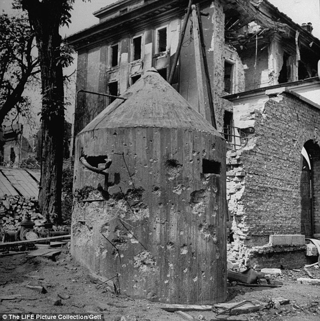 Losing: Hitler knew the Russians were approaching in his final days, as Berlin came under increased fire. Pictured: A bullet riddled pillbox watchtower outside the Reichschancellary building