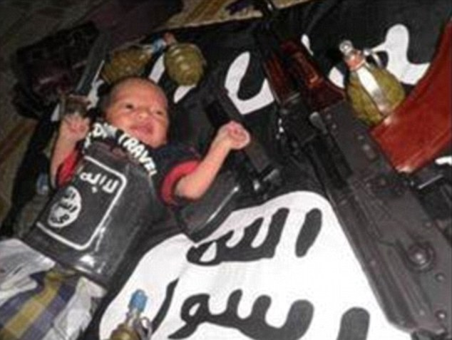 Disturbing: The images bear a strong resemblance to earlier ISIS propaganda, like this one of a baby lying on an ISIS flag surrounded by weapons