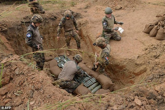 French soldiers prepare to blow up captured weapons and explosive devices in Bangui on December 4, 2014