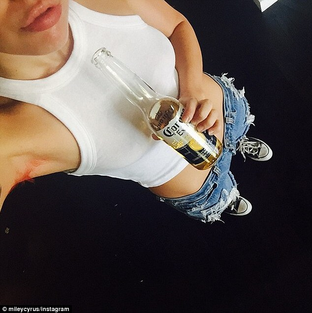 Cheers to me: The star toasted her new look with a beer