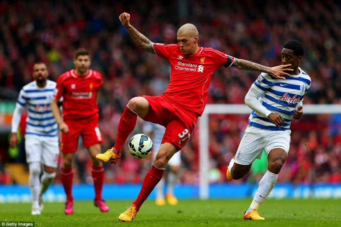 Liverpool defender Martin Skrtel controls the ball under pressure from QPR midfield player Leroy Fer