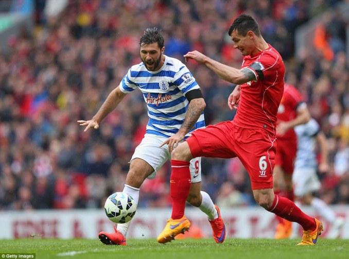 QPR striker Charlie Austin (left) takes on Liverpool defender Dejan Lovren in the Premier League game at Anfield