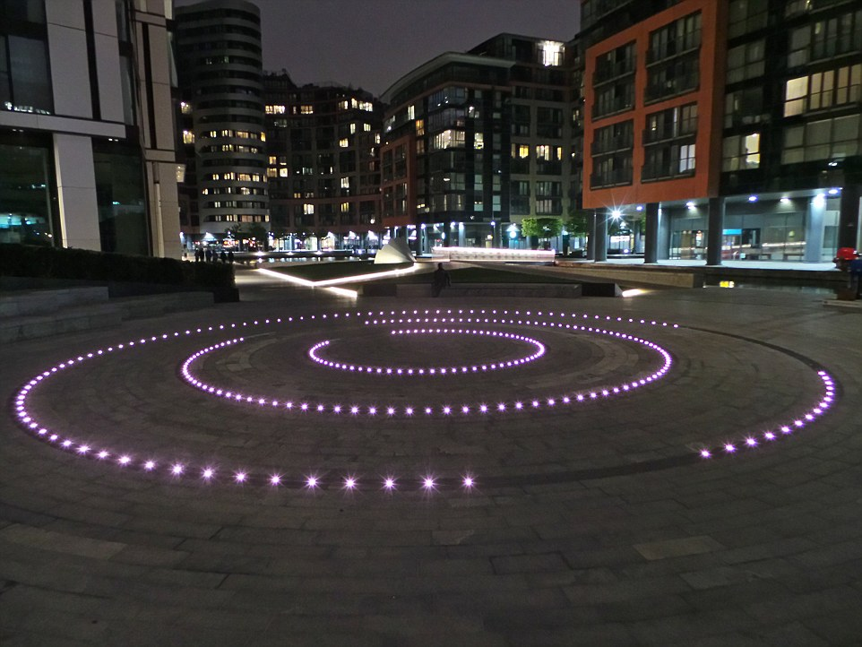 The Merchant Square Fountain in Paddington Basin has been lit up as part of city-wide celebrations following the birth