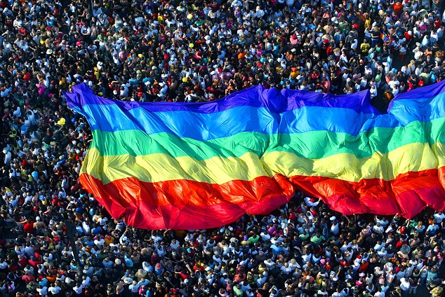 Thousands march at an LGBT parade: The change to commonly used titles has been welcome by leaders of the community