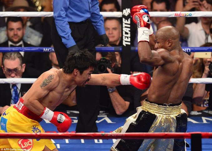 The American was dancing his way out of trouble as Pacquiao came out swinging without really finding his target