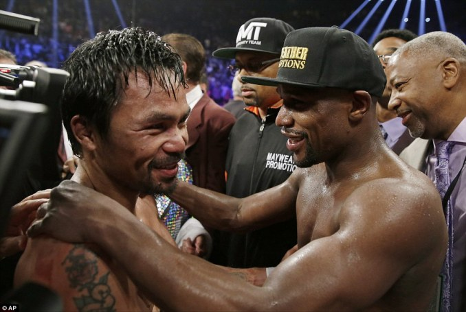 The fighters had an embrace and a smile for each other after going at it for 12 energy-sapping rounds in Sin City