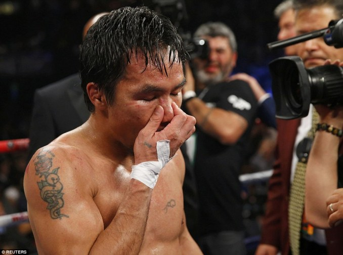 Pacquiao closes his eyes as he comes to terms with the loss after going the distance with Mayweather