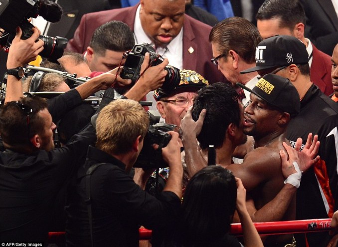 The cameras were all over Pacquiao and Mayweather as they hugged at the end of the fight