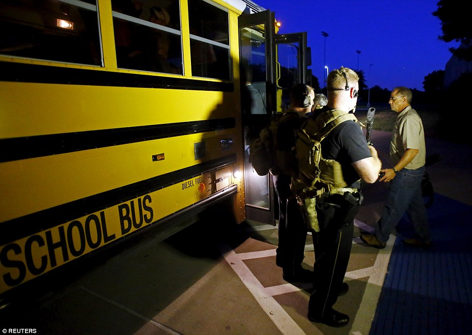 They were led off of a school bus into another building and were questioned by law enforcement