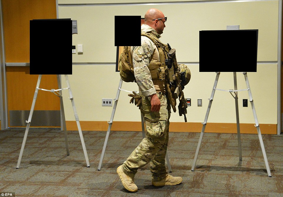 Heavily armed police secure art work before the Dutch member of parliament and leader of the far-right Party for Freedom, Geert Wilders, delivers the keynote address at the Muhammad Art Exhibit and Contest at the Curtis Culwell Center in Garland, Texas