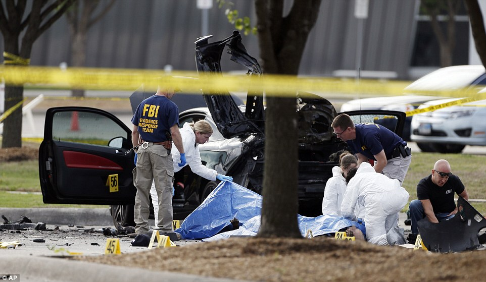 Killed: FBI crime scene investigators look at the bodies of the two killed gunmen outside the Curtis Culwell Center in Garland, Texas on Monday. Police killed the two men after they opened fire at an anti-Islam event on Sunday