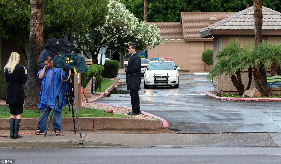 Search: Reporters gather near the home of Elton Simpson, one of the suspected attackers, in Phoenix, Arizona on Monday morning