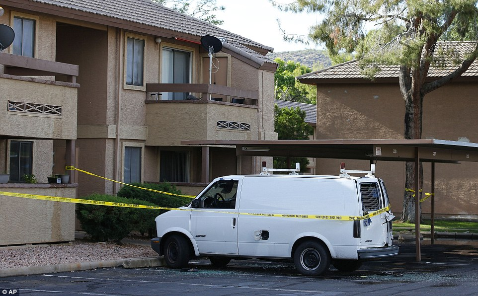 Raid: Police tape surrounds a vehicle, believed to belong to one of the two gunmen, in Phoenix, Arizona on Monday