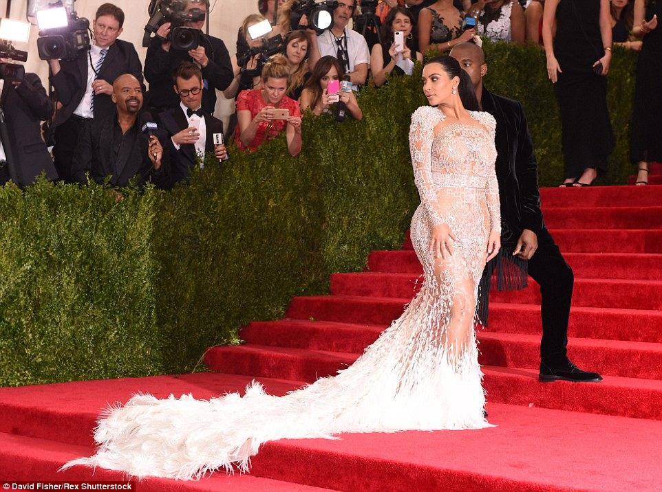 Over the shoulder: Kim gave her best come hither look for the cameras