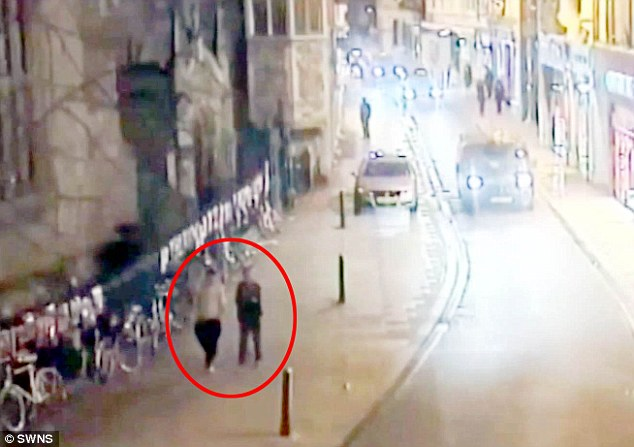 The two defendants (circled) were said to have been searching the Cambridge city for cameras prior to the alleged rape