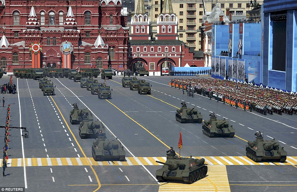 Soviet SU-100 tank destroyers drive during the Victory Day parade - Russia used the event to highlight its formidable military defence
