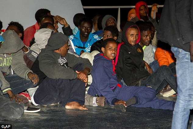 Desperation: Thousands of migrants and refugees like these children attempt the trip every year