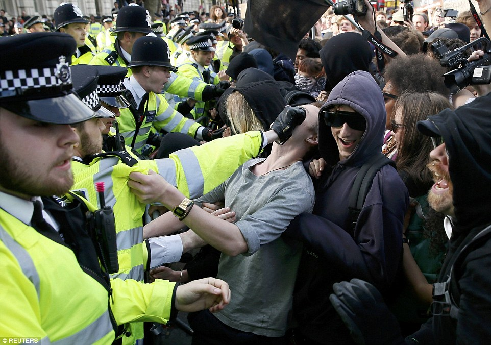 Officers tried to hold back the large group of protesters as they tried to push their way through the large police cordon on Downing Street