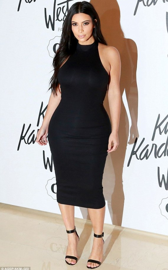 Nice curves: Kim Kardashian looked in perfect shape on Monday in Sao Paulo, Brazil, during a press conference for Kim Kardashian for C&A