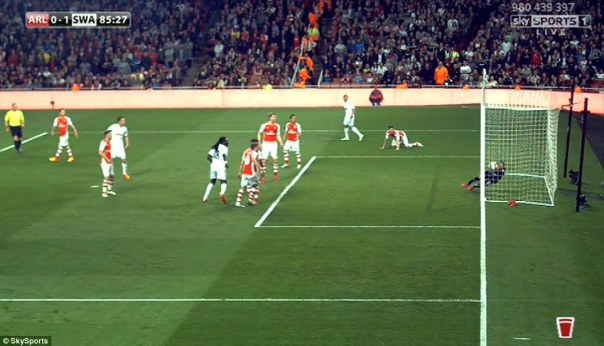 Arsenal goalkeeper David Ospina tries in vain to stop Bafetimbi Gomis' effort crossing the line in the 86th minute