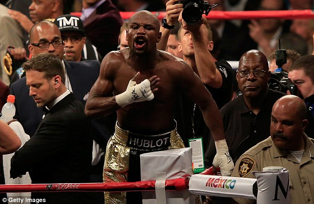 Mayweather pumps his chest after the judges deem him the winner of his fight against Pacquiao