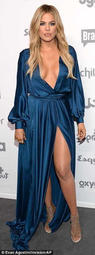 Beautiful in blue: The 30-year-old reality star sunned in a flowing satin dress which flaunted her ample cleavage and toned pins