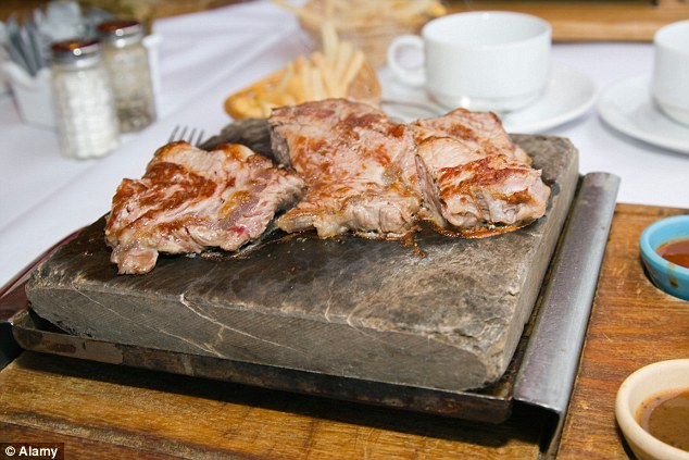 Disgusting:Nigerian restaurant has reportedly been shut down for cooking human flesh and serving it to customers (file photo of pork chops)