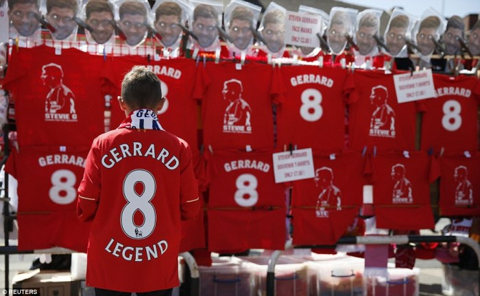 Iconic: A Liverpool fan looks over the  Gerrard merchandise available before kick-off in his final appearance at Anfield