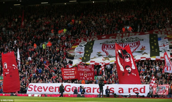 Inspirational: Liverpool fans hold aloft their banners and signs to adorn their talisman Steven Gerrard, who plays at Anfield for the final time
