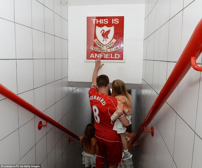Last time: Liverpool FC's famous number eight touches the 'This is Anfield' sign in the stadium's tunnel for the final time