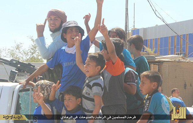 Shocking: Images found on Islamic State's various social media channels show tiny children celebrating alongside the militants in Ramadi, where the militants have already begun to execute captives