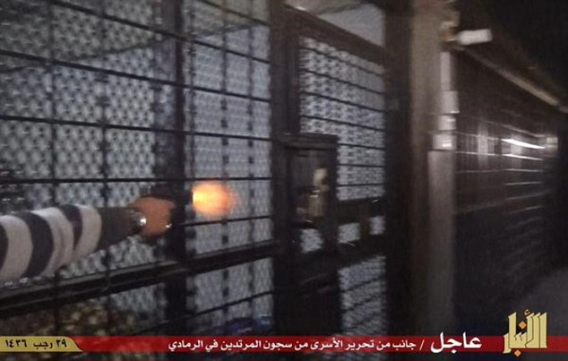 Pictures released by Isis purportedly show the terror group releasing prisoners from Ramadi having stormed into the city. A gun was fired at locks securing cells in the city's jail