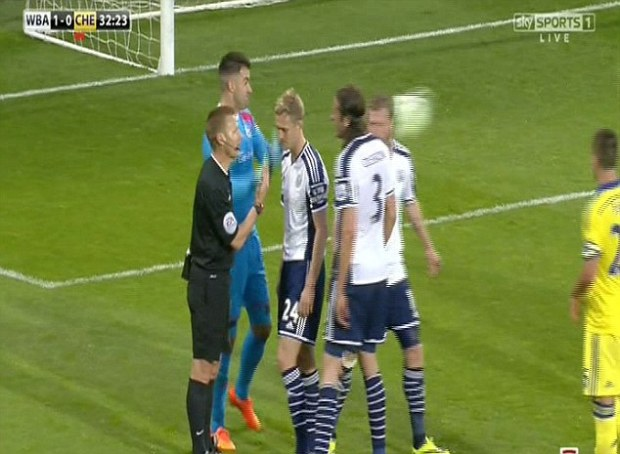 Cesc Fabregas received a red card from Mike Jones after firing a ball into the head of Chris Brunt