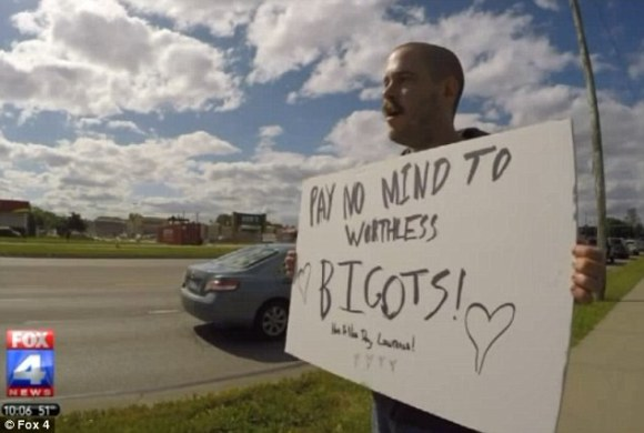 Fighting back: Some residents have begin protesting outside his store (above)