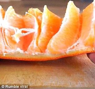 Peel an orange with a knife