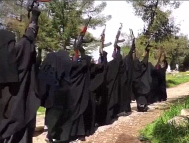 Brutal: Raqqa is patrolled by Islamic State's fearsome all-female Al-Khanssaa Brigade (pictured) who violently impose the group's twisted interpretation of Sharia Law