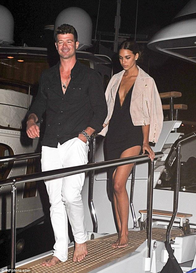 Lewis Hamilton Wears A White Tuxedo Jacket At Yacht Party