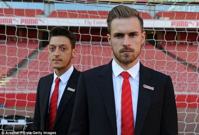 Aaron Ramsey, pictured alongside Mesut Ozil, has revealed he doesn't enjoy playing on the wing for Arsenal