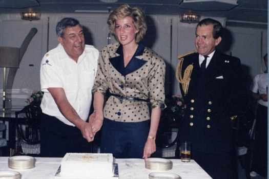 Icing on the cake: Princess Diana helps Norrie - the ship's longest serving yachstman - celebrate his birthday on board