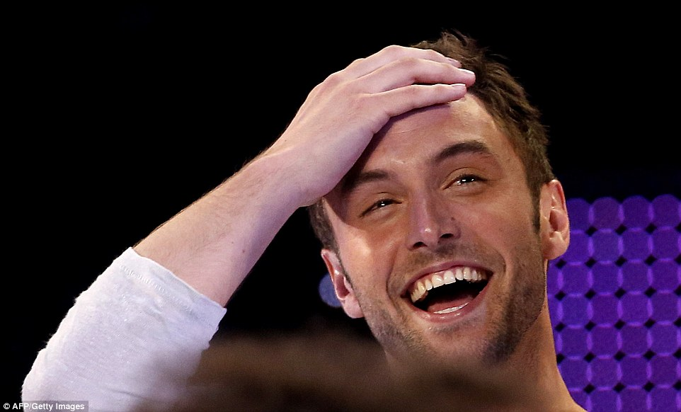 Swede success: Zelmerlow can't quite seem to believe it after being announced as the winner of the contest