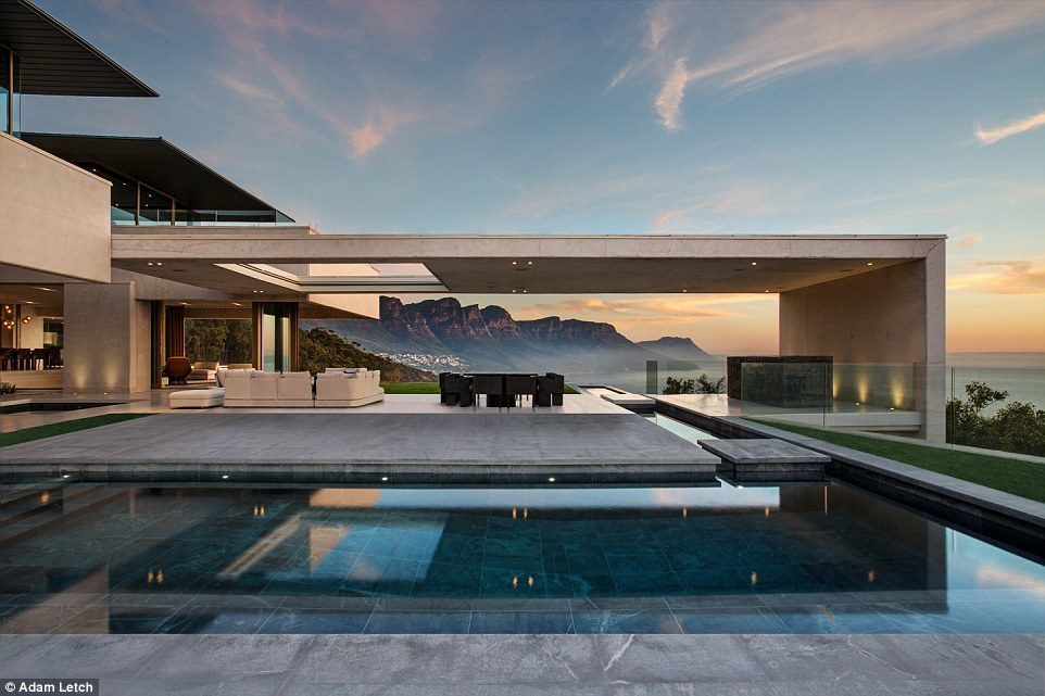 This multistorey dwelling in Bantry Bay, Cape Town, South Africa, appears to blend right into the coastline on which it is built