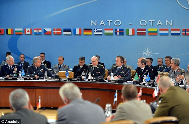 Concern: Nato officials meet in Brussels to discuss military policy, including growing tensions with Russia
