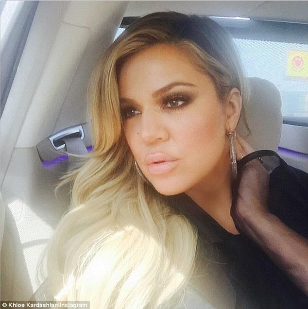 Khloe Kardashian Pouts And Wears A Black Hijab In Selfies