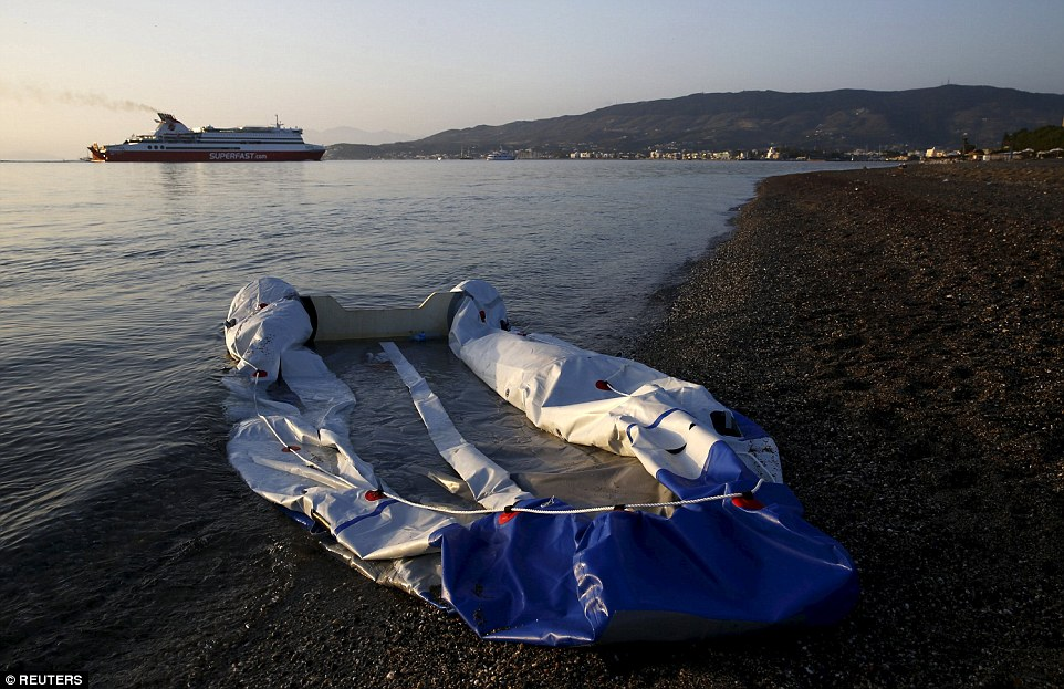 Deflated: This dingy boat was used to bring migrants from Turkey to the Greek island of Kos, but clearly won't be making a return journey