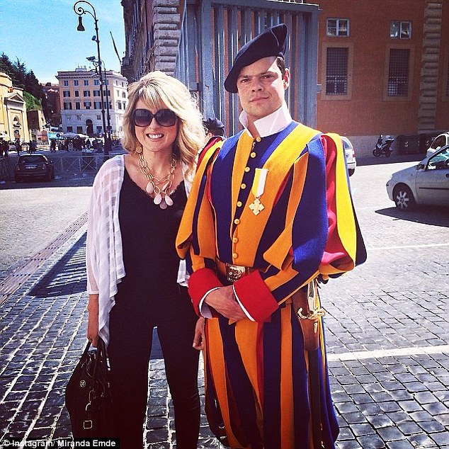 Unlikely match: Miranda Emde, 31, is pictured above with her fiancé Jonathan Binaghi - a former member of the Vatican's Swiss Guard
