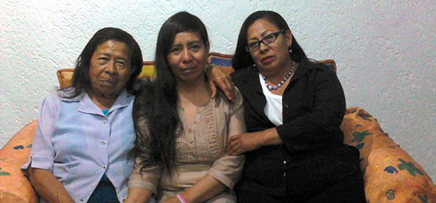 Victim: Claudia Tapia Herrera (centre)- here being comforted by family members - was so traumatized by Salas that she gave him all her money and credit cards. Herrara was initially arrested with Salas for allowing the abuse to continue for so long, but was suffering from Stockholm Syndrome
