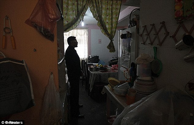 House of horror: An investigator inside the house in a Mexico City slum where Jorge Iniestra Salas imprisoned and abused two teenage girls for years