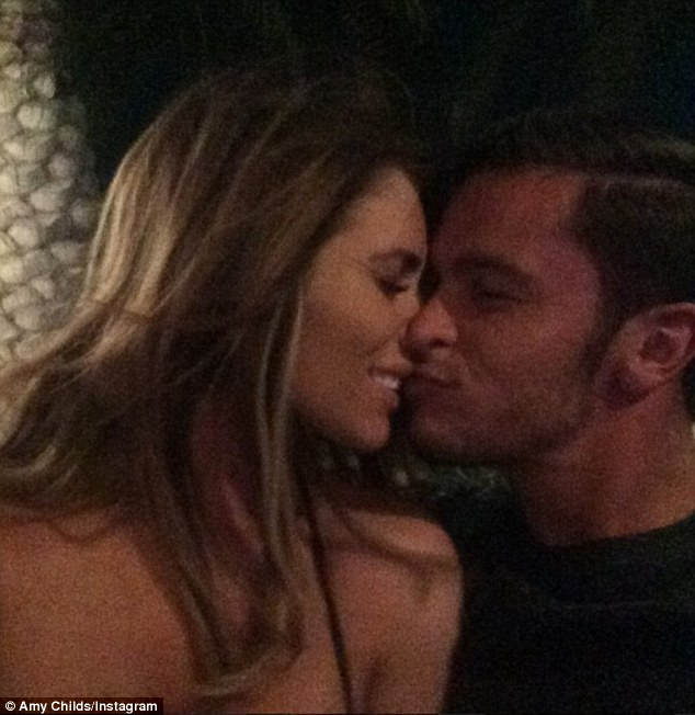'Happiest girl in the world': Amy took to Instagram to share an adorable kissing picture with her beau
