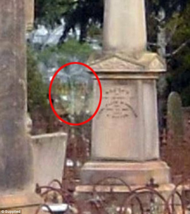 It is claimed a spirit can be seen in the background of this image taken in a cemetery near Toowoomba