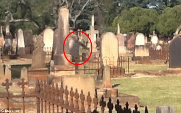 This picture, taken in May 2012, is said to be of a ghost hovering near a grave